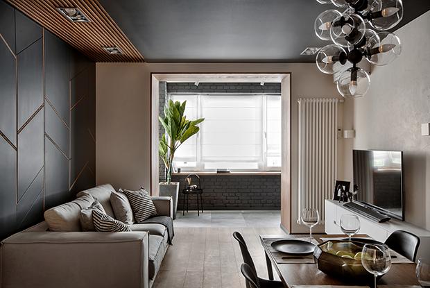 Графитовые стены и деревянные текстуры в четырехкомнатной квартире на ВИЗе