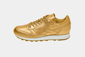Золотые кроссовки Reebok Classic Leather